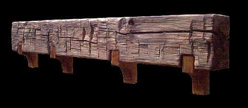 Salvaged antique Chestnut beams make excellent hand-hewn mantles.