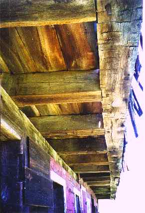 Detail showing large hand hewn timbers.
